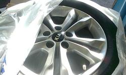 I have 4 rims and tires  OEM off of a 2011 kia optima EX sedan. tires and rims have 200km on them, swapped to winters and buying larger rims in spring. Perfect shape. fits any vehicle with 5x114.3 bolt pattern most midsize vehicles  17x 7.5inch rims tires