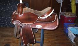 FOR SALE 17 INCH WESTERN SADDLE WITH SEMI QUARTER HORSE BARS . SADDLE IS FOR SALE BECAUSE IT DOES NOT FIT OUR DAUGHTERS NEW HORSE