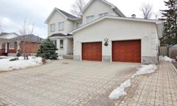 # Bath 3.5 MLS 1002432 # Bed 4 THIS IS A 10! Grand 4 bedroom and 4 bathroom home with custom touches and in-law suite with separate entrance. Beautiful interlocking driveway that can fit up to 4 cars side by side and 2 1/2 garage for extra storage.