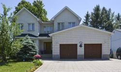 # Bath 4 MLS 1020976 # Bed 4 THIS IS A 10! Grand 4 bedroom and 4 bathroom home with custom touches and in-law suite with separate entrance. Beautiful interlocking driveway that can fit up to 4 cars side by side and 2 1/2 garage for extra storage. Hardwood
