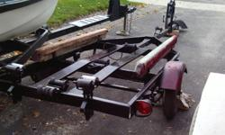 """18' bunk boat trailer with 8"""" tires, good lights, freshly painted, in good condition"""