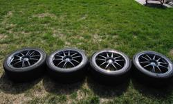 """Selling a set of 4 - 18"""" Enkei Rims. Gun metal spokes with a polished lip. 5 bolt universal pattern fits 5 x 114 and other 5 bolt patterns. The rims are 7.5"""" in width with 45mm backspacing. Rims come with a set of 20 special lug nuts and 2 sockets (see"""
