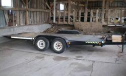 18 foot tilt and load trailer Fenders are a bit beat up but trailer is in very good shape. 2 -3500Lbs axles with brakes.   Serious inquiries only please.