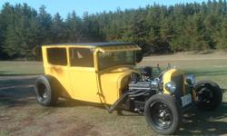 """1927 Model T Sedan   New Speedway front axel with disc brakes New aluminum rad 305 engine turbo 350 transmission 10 bolt Chevy rear end New master cylinder New Vega steering box New chrome water pump New chrome oil pan Body chopped 3"""" 2""""x3"""" square tubing"""