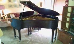 Beautiful piano in mahogany case. Approximately 6 feet in length.