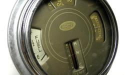 1939 Ford Truck factory gauges cluster fuel, oil, temp, amp beautiful clean condition original looking, good graphics with bright shiny chrome bezel, gauges appears in working condition except for the temperature gauge its connection has being cut on back