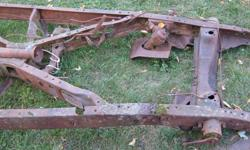 The frame is decent, will need restoration, obviously.  The rear suspension and differential is there. Also the rear brakes.  The gas tank is there but it's rotten.  Some of the brake pedal assembly is there.  The steering box is there.  There are some