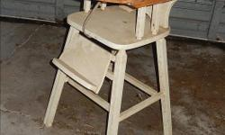 Despite being a little dirty, this sturdy chair is still in working condition - still has the safety strap between the tray and seat. All DIYers, this would make an excellent plant stand in a country kitchen or sun room.