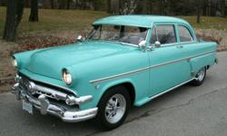 Powered by 302, 3 speed on the floor Hurst shifter.  Strong runner, very dependable.  Razor straight, super clean.  Original stock color (sky haze green).  Chrome and stainless in excellent condition.  Brand new Craigers with spinners.  This car is a real