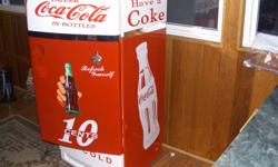 FEATURED HERE IS A RESTORED 1952 FRIDGE, NOT TO LARGE AND ECONOMICAL TO RUN. WORKS PERFECTLY AND LAID OUT IN THE COKE COLA GRAPHICS. THIS WOULD BE AN EXCELLENT ADDITION TO A REC ROOM OR MAN CAVE. 705 737 3914 EVES, 705 721 9877 X 125 DAYS,