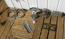 Various parts for '56 and '57 chev. - radio, chrome headlight frames, windshield washer bottle, chrome wind deflectors. $25 for the lot. 705-745-9165