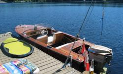 One of a kind wooden boat built by a period boat builder or possibly a Shepherd Ski-bee. 1958 Mahogany Planks on Oak frames. 16' runabout. Powered by a 1958 Johnson Super Sea Horse 50hp in excellent running condition. The motor was the first V50 Johnson