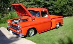 Chevy 3100 Pickup. Professionally built pro street truck. Starting off with exceptional rust free straight body, this truck was built with all the best parts available and has been driven 1800 miles since completion. Some highlights include; Porsche Red