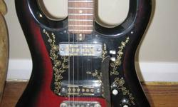 1960's TEISCO guitar w/ Rare Gold Foil Pickups Looking for a unique 60?s sound AND a beautiful collector?s guitar? This vintage Teisco is in 100% immaculate condition except for the common missing Teisco logo on the top of the headstock. Any apparent