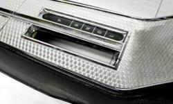 1964 Chevrolet Impala Super Sport original factory black Automatic floor console in good condition. It has a beautiful swirl pattern on a top of aluminum plate the glove box lid does not catch and along the carpet line at the very back by the courtesy