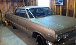 63 Chev Impala 4 door hard top 283 2 speed new motor, suspension, tires etc. Asking $8000 certified.