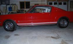 A BEAUTIFUL 65 RED MUSTANG FASTBACK 2+2 V 8 289 4 SPEED ONLY PAINTED ONCE.IT WAS PURCHASED 4 YEARS AGO AT A BARRETT JACKSON AUCTION.EXCELLENT CONDITION. ALWAYS STORED INSIDE. NUMBERS MATCHING CAR. PRICE GOES UP IN THE SPRING.