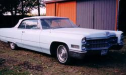 We have for Sale a 1966 Cadillac Sedan DeVille Convertible. Light blue exterior with White leather interior and convertible top. Split bench in front. Never seen a winter.Recently started and run. Mileage approx 65,000  original MILES. Asking $11,999.00
