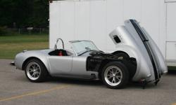 A 1966 Shelby Cobra replica.Fiberglass body.w/tilt front end.Easy access to engine and ride height adjustment. 5.0 litre HO Ford V8,600holley,proform dist. T-5 5sp.transmission 8.8 traction lok rear dif. Custom fabricated chassis Black leather interior