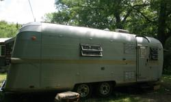 Rare vintage travel trailer for sale. $4000. trailer has been gutted and repainted. old appliances have been taken out (but need replaced), plumbing and electrical redone. new tires and towing package. It is only partly renovated so it still needs work.