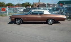 1968 impala cutom coupe, 327 auto, one owner BARN FIND parked since 1985 until last year, new dual exaust, new tires, Has tilt wheel and power trunk options. Vinyl roof is perfect, same as all stainless. orginal paint from moulding up. Still has factory