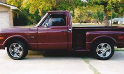 This beautiful 1969 Stepside is in good, working condition, with a 1992 Chevy 454 and a 3-speed automatic transmission, wood bed, and almost perfect maroon paint job.