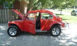 This is a Chev Corvair powered (engine and transaxle -2.7 litre all aluminum 6 cyl) VW Baja Beetle. It is recreational driven and is a very reliable highway runner. No problem cruising on todays highways. Will take very little to safety at Johns Bug Shop