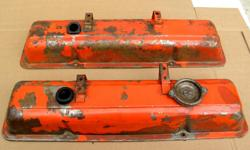Factory original small block Chevrolet steel valve covers matching pair believe to be original Tonawanda covers reddish orange covers need to be blasted and repainted with oil cap AC-FC2 $35.
