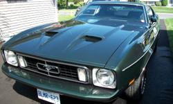 1973 Ford Mustang fastback, 87,000 miles, dark green with black interior. Frame on restoration 9 years ago, 2,000 miles done since.  The interior is just like new and loaded with factory options such as : P/B, P/S, A/C, AM-FM cassette, factory RPM, even