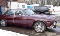 1973 JAGUAR XJ12, 4 door coup, maroon in color, dual exaust,dual fuel tanks,. 12 cylinder (needs some work), professionally reupolstered in side, garage stored, no rust. Insurance appraised at $16,000. only asking $2,400. call 807-345-1054 cell