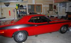 a beautiful car 340 slapstick around 65000 miles  red with the traditional black stripe.Stored indoors, purchased 4 years ago. Driven only 200 miles in last 3 years.