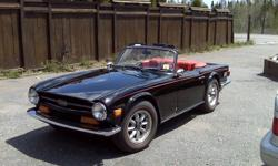 1973 Triumph TR6  convertible. Black exterior with red interior, red stripe body line and red stripe tires. 42000 original miles on the car. Body off  restoration done in 1992 only 4000 miles put on the car since then. Show room condition. This car is
