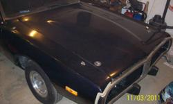 Here we have a 1974 dodge charger for sale. it has a 318 and a factory manual transmission with original hurst shifter floors are solid as well as the frame. needs new carpet and headliner. it also needs an ignition switch to run properly. but it DOES