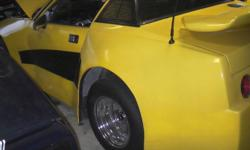 1976 triumph tr7 all modified with 327 crate motor band new v8 aluminium heads with 700 demon crab great track car 4' ford rear end 4 speed tranny with over drive cool looking car must see great summer car no time for me. $7000 obo