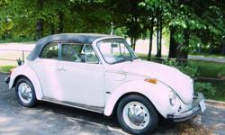 VW Beetle Convertible Karmann Edition   never driven in inclement weather. Winter stored. Regular maintenance . Exterior has bright white pearly paint and interior is white with gray roof.  Chrome bumpers   Mileage is in miles and not kilometers.  Ready