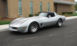 Gorgeous 1980 Corvette with all original equipment.  This matching numbers car is very clean on all levels.  Pampered and garage stored every year.  Silver with dark blue interior.    Full Engine and Transmission rebuild to original GM specifications.