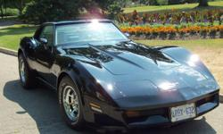 2 door 1980 Corvette, with T Tops , automatic transmission,   power windows, Stored Indoors, mint condition, Black on Ivory,   Chrome rims, New Rubber, Beautiful Car, come and take a look.   Call 519 751 0948