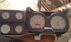 Instrument cluster from 1986 GMC half ton pick up with manual transmission. Added white face gauge kit. In excellent condition. All gauges working properly. 210 000kms on odometer. Asking $100 or best offer.  905-730-7641