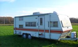 Great condition, well maintained 1982, 23ft Prowler travel trailer. Has full queen bed, two bunks in back, fold down dinette, lots of storage inside and out, full bathroom with tub and shower, four burner stove and oven, microwave, new electric fridge,