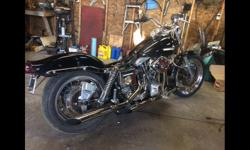 80 cui shovelhead Super B carb Motor built by previous owner Aftermarket cam Hydraulic lifters New seats Wide glide tanks Lowered Bobbed back and front fender Forward foot controls New handlebars New battery Chrome swing arm and chain guard 4 boxes of