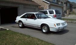 Newer 5,0 H.O 5spd alun intake eldelbrock carb, brand new weld wheels,nice interior,too many new parts to list,lots of extra parts, needs a  little bodywork and paint. mostly original paint.Rare car 20th aniversary.Call 519 753 9936 or 519 717 3656 no