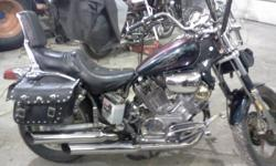 First off im selling for a friend. He told me to post it and for model im not sure. But the bike runs good. Sounds nice. Loud.. has alot of chrome accessories.extended foot rest. Shifter lever. Some gold trim. Bike allways stored in heated shop and