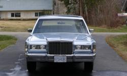 This classic car has never been winter driven and has been garage stored and well maintained.It has all the bells and whistles of the time,Landeau roof, keyless entry, power trunk, power seats,power windows,moon roof trip log etc etc It has smokey blue
