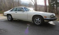 """MAKE ME AN OFFER! Powerful 5.3 litre HE v12 Coupe. Automatic transmission with rear wheel drive. """"Old English"""" white exterior. Navy blue leather interior. Exterior has a tiny area of rust bubbling under the paint near the rear passenger tire and there is"""