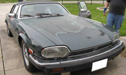 V12 5.3 litre they only made this model for two years and they made around 4000 of them, a 2-seat car. The XJ-SC was not a full convertible but had a non-removable centre targa-type structure and fixed cant rails above the doors. the rear hardtop can be