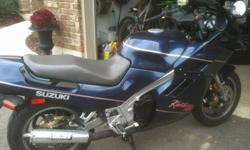 1988 Suzuki 1100 Katana with some cosmetic damage. Bike runs excellent with only 18,000 km on it. Damaged - upper fairing, headlight and left signal light, left hand mirror is scratched. The rest of the bike is excellent condition. I am the second owner.