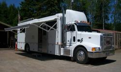 Completely rebuilt  cab,  3406 Cat  425 HP  13 speed, Propane 6.5 Onan generator.  125 gal fresh water, 75 gal grey water, 55 gal. black.  Remote control awning.  40ft overall. Custom built 28ft living space with custom made all Hickory cabinets.  Granite