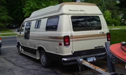 1991 driveable self contained Pleasure Way camper van Dodge ram 250 with 318 engine, 3 way fridg., microwave, propane furnace and 2 cooking elements, toilet, tv., roof fan, table at rear that goes down into double bed, seat belted for 5 people, awning,