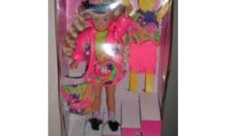 """I am selling  a STACIE barbie doll, Littlest sister of Barbie from MATTEL. She is from 1991 and has never been removed from her box. There is still the original sticker on the top right corner of the box which reads """"KAY BEE, $11.99"""" Stacie shares her"""