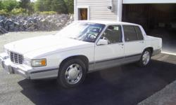1992 Cadillac Sedan DeVille, in excellent condition, has not been winter driven. Original paint, 4.9 L motor, white with burgundy leather interior, originally from British Columbia.